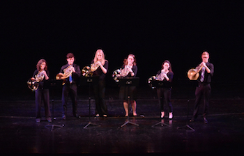 musical student performance with brass instruments