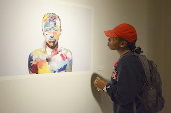 student looking at artwork