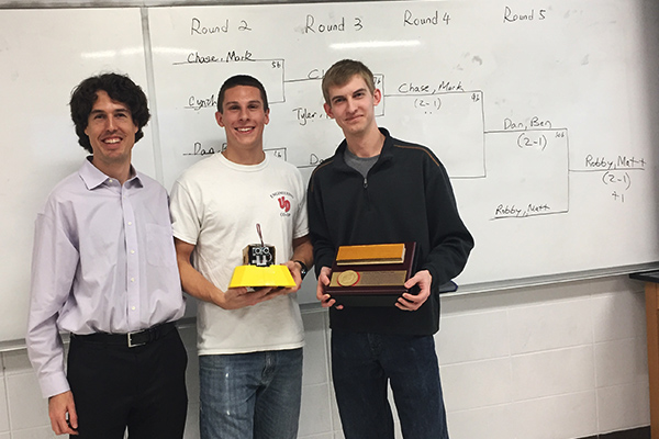 Dr. Tim Reissman with Sumo Bot competition winners, Brandon Smith and Kyle Vanden Eynden