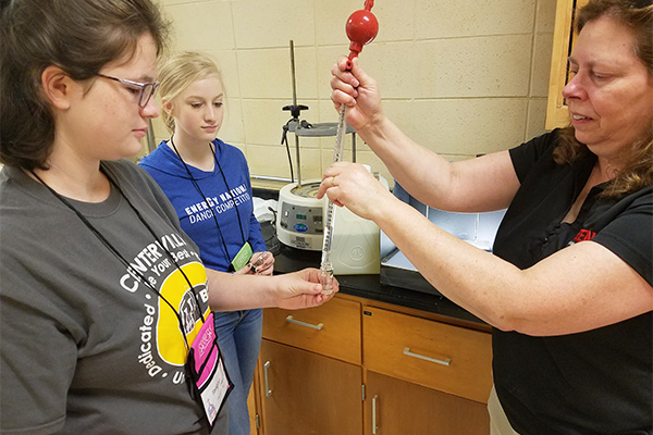 (r) Denise Taylor, professor, civil and environmental engineering, with WIE campers during Experiments in Engineering segment