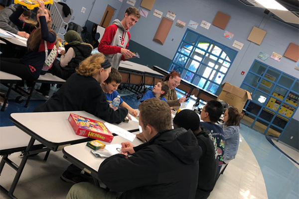 Kiser Elementary students and UD Wheels for Kids members playing games and coloring at the giveaway event.