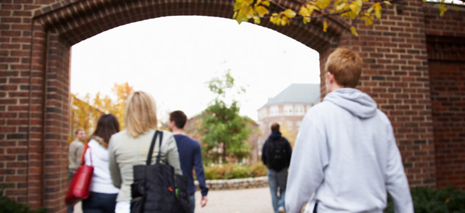 Students walking through arch