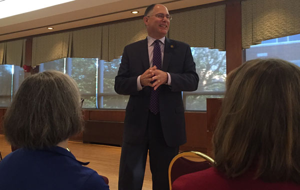 The University of Dayton President Eric Spina speaking to a group of people