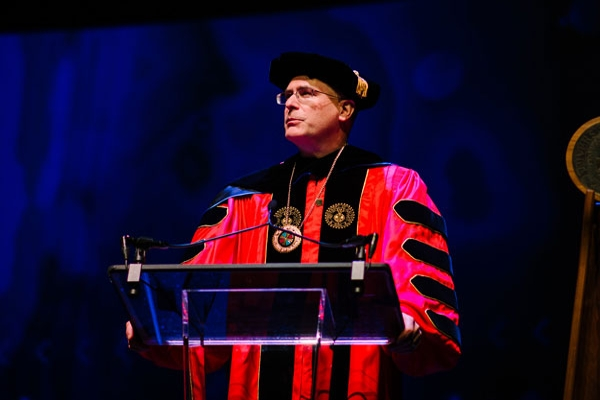 The University of Dayton President Eric Spina speaking at a graduation ceremony